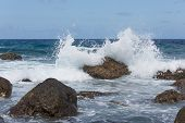 Breaking Waves At Rocky Coast Of Madeira Island