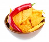 Tasty nachos  on color bowl, isolated on white