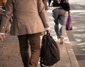 Man In Beige Clothes On Sidewalk