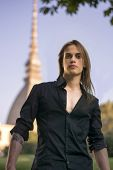 image of turin  - Handsome young man next to Mole Antonelliana symbol of the city of Turin Italy