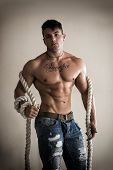 Muscular Man Shirtless With Heavy, Big Rope