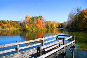 stock photo of board-walk  - Board walk near the lake in autumn time - JPG
