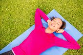 fitness, sport, training, park and lifestyle concept - smiling african american woman doing exercise