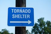 Tornado shelter sign to guide people to safety in tornado emergency