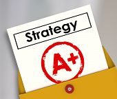 Strategy document in a yellow envelope getting an A+ review as a successful plan for achieving succe