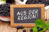Slate Blackboard With The Germans Words: Aus Der Region