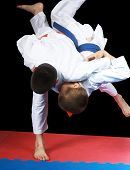 Beautiful high throw are doing  sportsmen in judogi