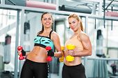 Women Doing Workout With Barbells