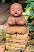 Smiling Buddhist Novice Made Of Clay, Thai Style