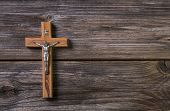Wooden Cross With Jesus On A Background For A Obituary Notice.