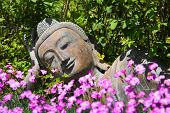 Garden Decoration With A Lying Buddha.