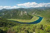a bend of Crnojevica River in Lake Skadar National Park, Montenegro