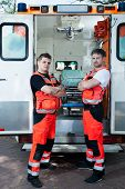 foto of paramedic  - View of male paramedics outside the ambulance - JPG