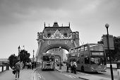 LONDON, UK - SEP 25: Tower Bridge with tourists and traffic on September 25, 2013 in London, UK. It