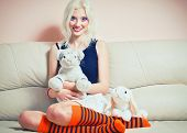 foto of cute tiger  - Closeup portrait of a cute blonde girl with rabbit and tiger toys - JPG