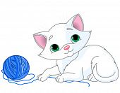 White kitten playing with a ball of yarn