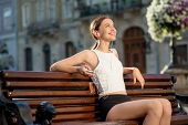 Runner Have A Break On The Bench In The City. Female Fitness Jogger Training Outside For Healthy Lif