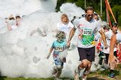Father And Son Run Through Foamy Bubbles At Bubble Palooza