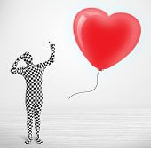 Cute guy in morpsuit body suit looking at a red balloon shaped heart