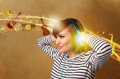 Pretty young woman with headphones listening to music, instruments concept