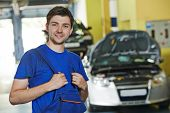 image of assemblage  - repairman auto mechanic portrait in car auto repair or maintenance shop service station - JPG