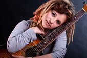 picture of dreadlocks  - Portrait of a girl with dreadlocks holding guitar - JPG