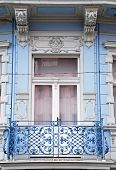 Ornate Baroque Window With A Balcony In Old Blue Building
