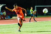Sisaket Thailand-august 13: Komkrit Camsokchuerk Of Sisaket Fc. (orange) In Action During Thai Premi