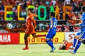 Sisaket Thailand-august 13: David Bala Of Sisaket Fc. (orange) In Action During Thai Premier League