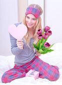 Portrait of cute excited woman read romantic heart shaped greeting card, awake and surprised of gentle romantic presents on Valentine day