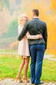 Young Couple Embracing In Autumn Park