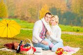 Picnic Young Couple In A Beautiful Setting In The Autumn Park