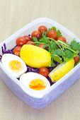 foto of lunch box  - Mix vegetable salad and boil eggs in plastic lunch box - JPG