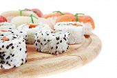 Постер, плакат: Maki Sushi and Nigiri California Maki Roll made of fresh raw Salmon Cream Cheese and Avocado insi