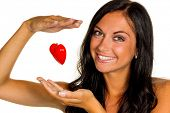 a young woman holding a love heart in hand