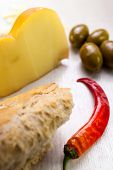 Food Composition Of Baguette, Chili Pepper, Green Olives And Cheese.