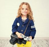 Child with camera. Little girl photographing