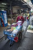 BANGKOK, THAILAND - DECEMBER 25, 2014: Street Photography of Street market in China town. Roll grill for cooking traditional Thai food.