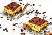 Tiramisu Cake With Coffee Beans And Cinnamon