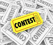 Contest word on tickets in a pile to illustrate the winning ticket drawn and prize awarded to lucky person or player