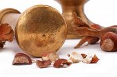 The Hazelnut And In The Leaf Old Metal Nutcracker On White Background