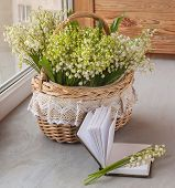 Basket With Lilies Of The Valley (convallaria Majalis) And Notebook With Blank Pages