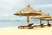 Sun Loungers With Parasols On A Beach