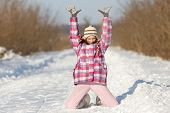 Girl Playing On Snow