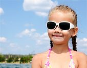 Outdoor Portrait Of Cute Little Girl Looking Away
