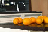 Oranges On The Kitchen Table