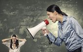 Woman Shouting Using Megaphone To Stressed Woman