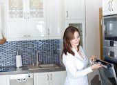 Woman Opening Oven Door