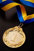Gold Medal On A Dark Background