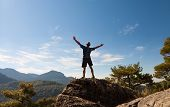 Sportsman On Top of mountain . Sport And Active Life Concept
